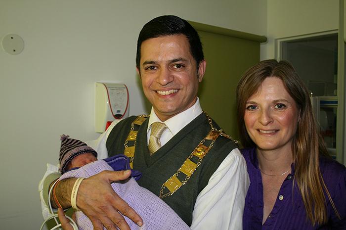 Mayor of Runnymede, Cllr Iftikhar Chaudhri holding baby Marshall with Mum, Jo Thorp-Lee