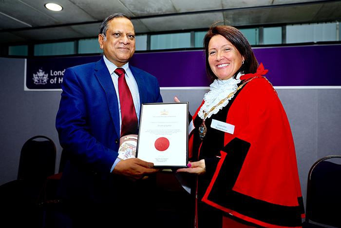Mr Gupta receives his award