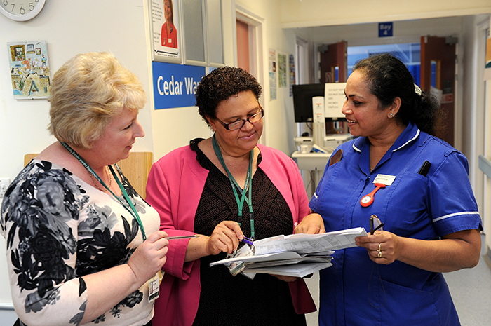 Staff members discussing notes
